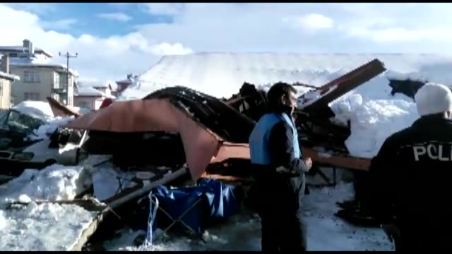 roof of a marketplace at aksehir district collapses after snow accumulation in konya central province of turkey on january 05 2017 four people pulled... - konya stock videos and b-roll footage