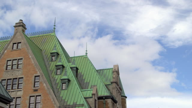 Roof of Chateau Frontenac under cloudy blue sky