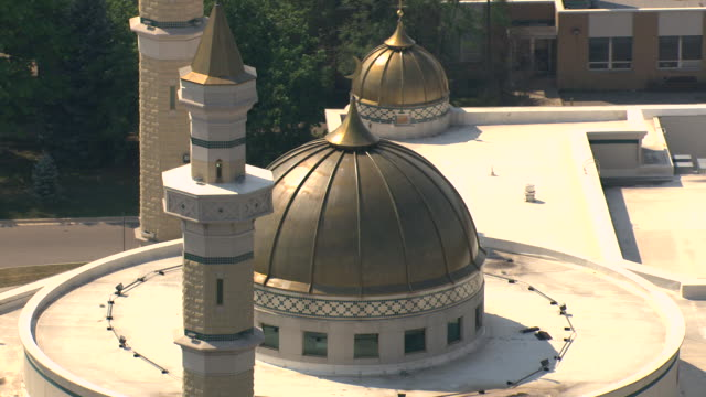 cu aerial zo  roof of mosque with minarets and islamic center of america with surrounding parking lot / dearborn, michigan, united states - dearborn michigan stock videos and b-roll footage