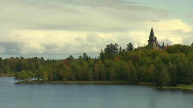 ws roof of old castle rising above treetops / vaxjo, sweden - vaxjo stock videos & royalty-free footage