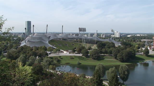 WS ZO PAN Roof of Olympic arena from 1972 Olympic games and park around with tele tower / Munich, Bavaria, Germany