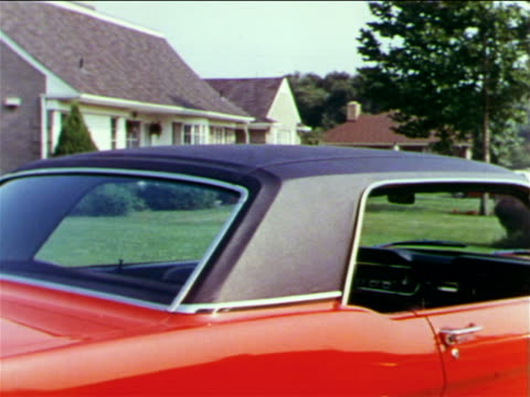 1965 roof of red ford mustang parked in front of suburban house / industrial - ford mustang stock videos and b-roll footage