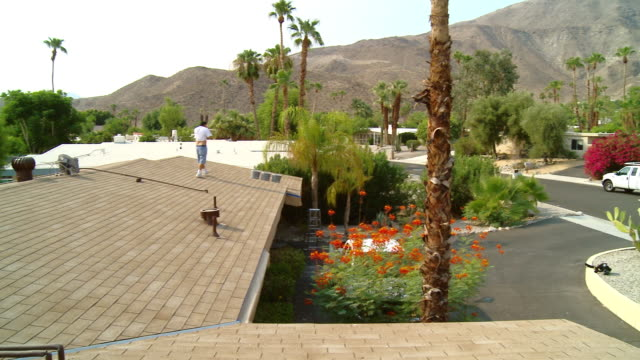 ws pan roof of residential home covered with brown composite shingle roof tiles / rancho mirage, california, usa.   - rancho mirage stock videos & royalty-free footage