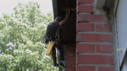 Roof Renovation. Manual worker use safety harness and safety line  and working on a roof repair
