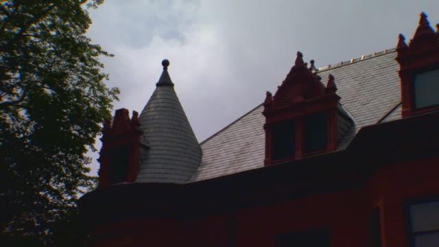 roof top of an ornate older building - れんが造りの家点の映像素材/bロール