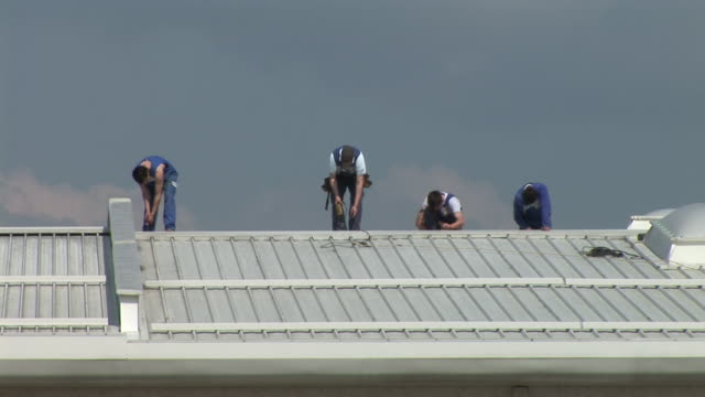 hd: roof work - roof stock videos & royalty-free footage