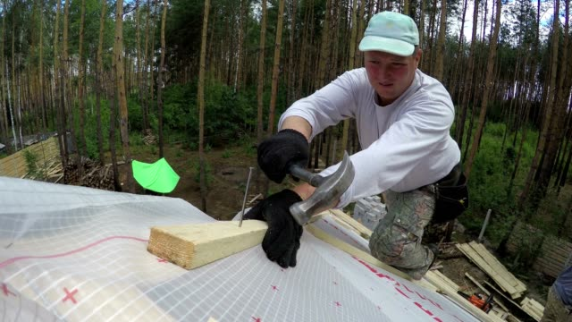 Roofer clogs the nail.