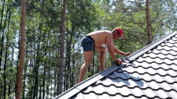 Roofer works on the roof.