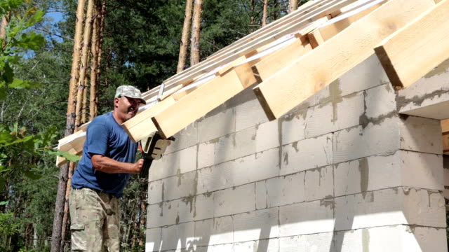 roofer works with the chainsaw. - chainsaw stock videos & royalty-free footage