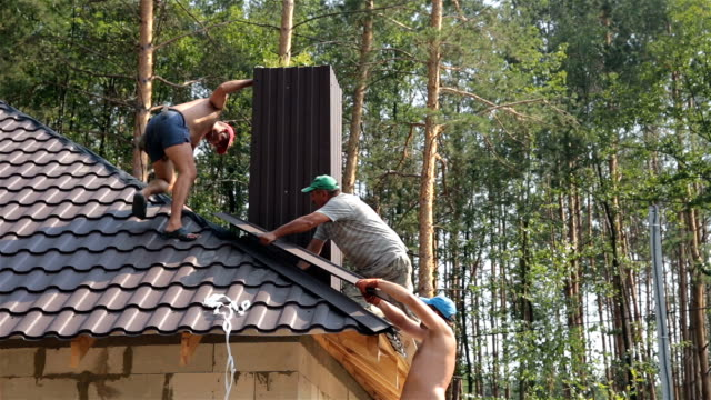 Roofers build the roof.