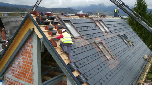 aerial roofers laying tiles on a new house - 20 29 years stock videos & royalty-free footage