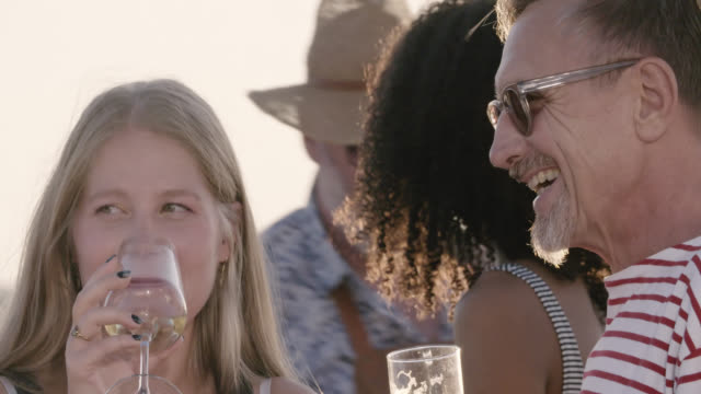 stockvideo's en b-roll-footage met rooftop barbecue party - close up shot of still trendy father and mother in their 60s and their daughter in her 20s on sunny summer day. - sunny