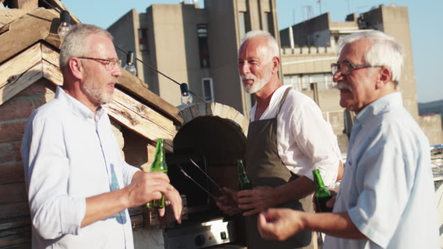 rooftop bbq - mature adult stock videos & royalty-free footage