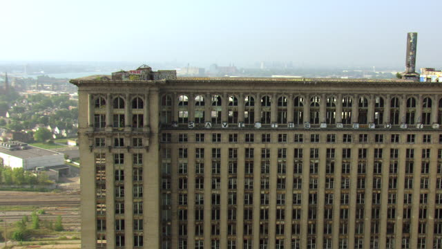 ms aerial rooftop of michigan central station with graffiti and broken windows / detroit, michigan, united states - bad condition stock videos and b-roll footage