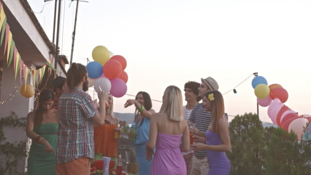 rooftop party fun - patio stock videos & royalty-free footage