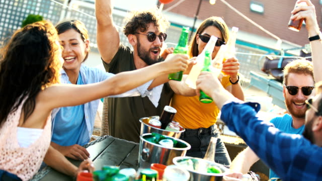rooftop party on a summer afternoon. - cooler container stock videos & royalty-free footage