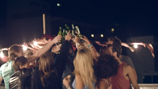 rooftop party - celebratory toast stock videos & royalty-free footage