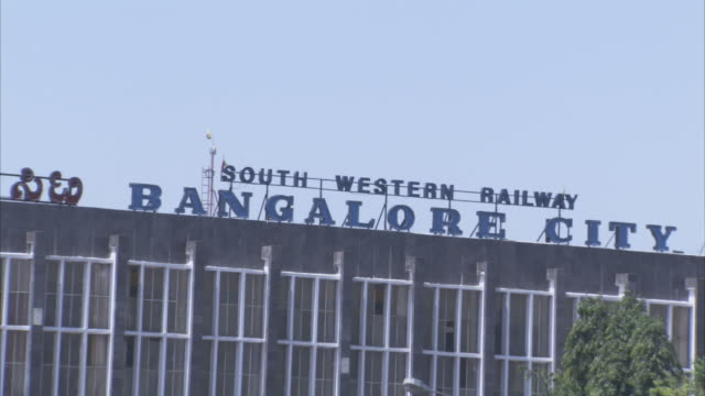 a rooftop sign identifies the south western railway station of bangalore city. - bangalore stock videos and b-roll footage