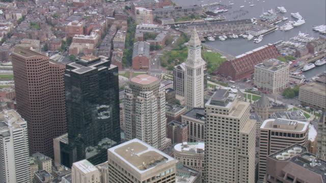 aerial rooftop spire of custom house clock tower and other downtown buildings / boston, massachusetts, united states - custom house tower stock videos & royalty-free footage