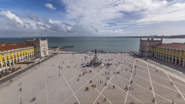 Rooftop timelapse of the the famous Commerse square with torists athe the Lisbon, Portugal. April, 2017