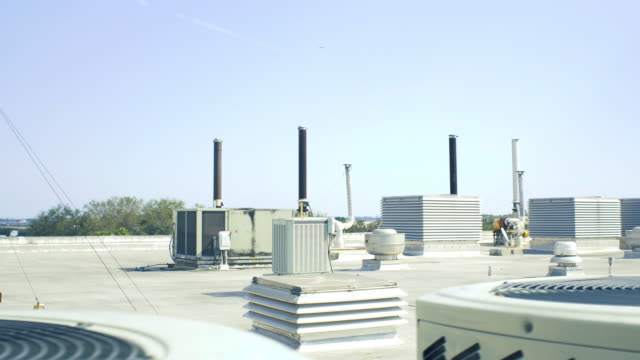 rooftop with industrial vents and ac units - rooftop stock videos & royalty-free footage