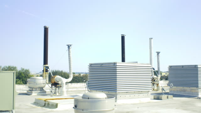 rooftop with industrial vents and ac units - air duct stock videos & royalty-free footage