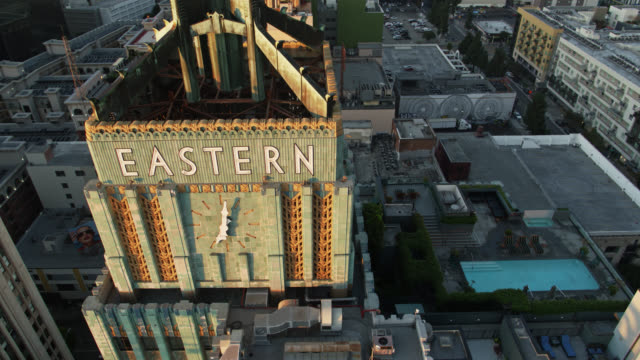 dtla rooftops and eastern columbia building clock - aerial view - infinity pool stock videos & royalty-free footage