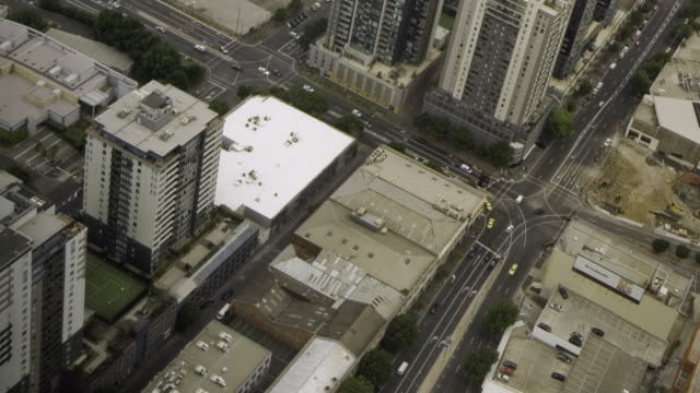 T/L, AERIAL, ZI, Rooftops and traffic on street intersection, Melbourne, Australia
