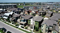 Rooftops covered with Solar Panels Aerial Drone View above East Austin , Texas , USA high above Solar Panel Suburb Community