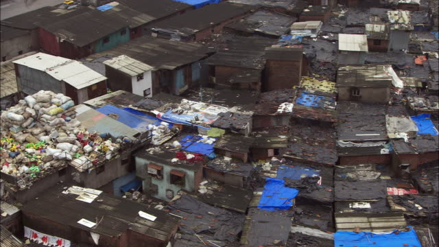 Rooftops of a shanty town in Mumbai, India. Available in HD.