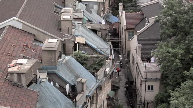 ha ws rooftops of apartment buildings behind nanjing road west/ shanghai, china - nanjing road stock videos & royalty-free footage