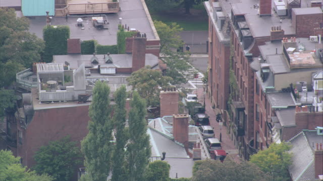 aerial rooftops of brick and brownstone buildings on a boston street / massachusetts, united states - boston massachusetts stock videos & royalty-free footage
