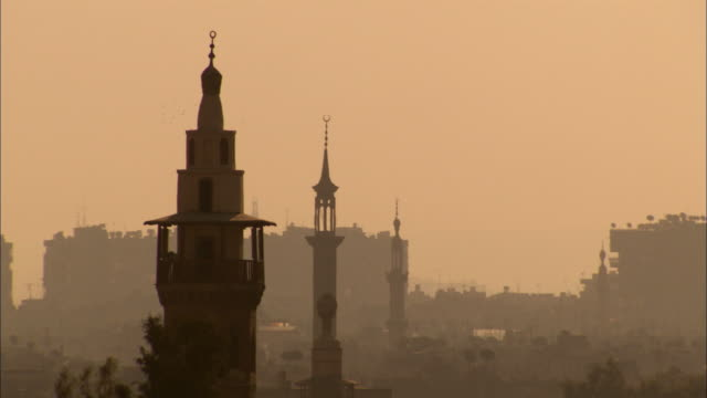 rooftops of damascus at sunset available in hd. - syria stock videos & royalty-free footage