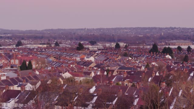 rooftops of english town - suburban stock videos & royalty-free footage
