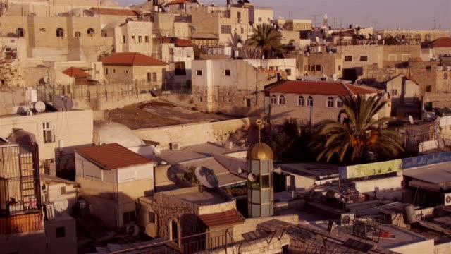 rooftops of jerusalem old city in beautiful golden light. - spoonfilm stock-videos und b-roll-filmmaterial