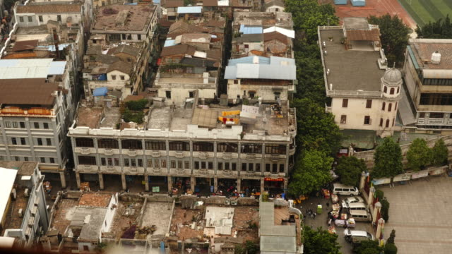 rooftops of residential district in guangzhou, china from above. loctated in front of sacred heart cathedral - spoonfilm stock-videos und b-roll-filmmaterial