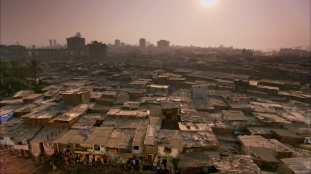 Rooftops of slum at sunset. Available in HD.