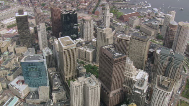 AERIAL Rooftops of tall, downtown buildings / Boston, Massachusetts, United States