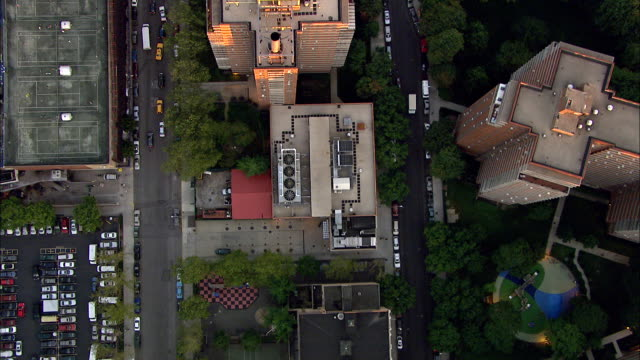 rooftops of various mid-rise buildings in lower manhattan area, including partial 40 wall street building traffic passing below on streets. nyc - manhattan stock videos & royalty-free footage