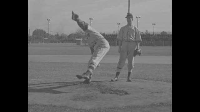 Rookies exercise on baseball diamond at Orlando training camp / rookies throwing and catching / Brooklyn Dodgers pitcher Van Lingle Mungo...