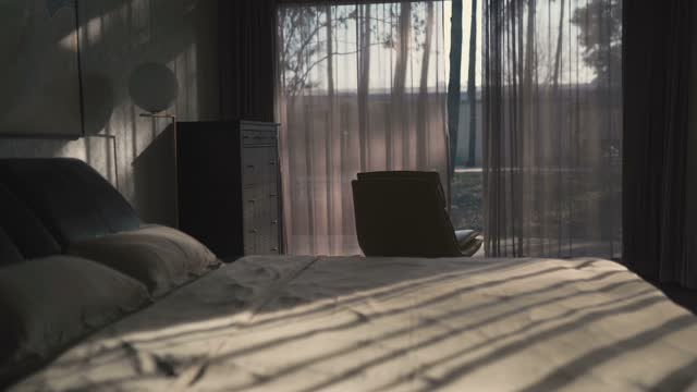 room with morning sunlight - modern bedroom stock videos & royalty-free footage