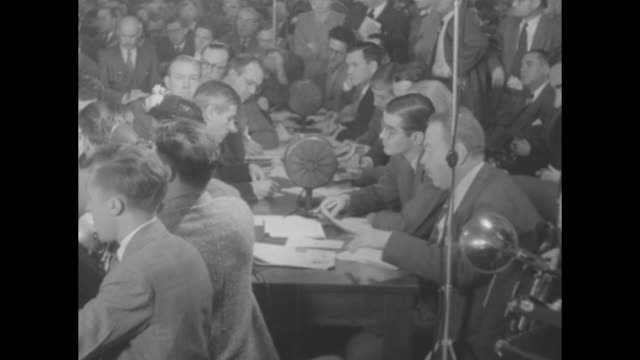 roomful of people in attendance at tydings committee testimony of louis budenz; some are seated at tables, taking notes / budenz at the witness table... - journalist stock videos & royalty-free footage