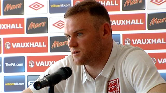 Rooney returns to England team Walcott injury scare 17612 Side Shot Rooney carrying son Kai from hotel to car Wayne Rooney speaking at press...