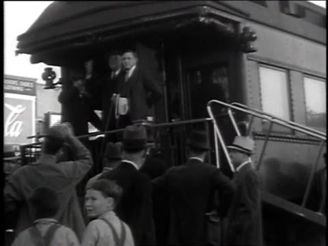 stockvideo's en b-roll-footage met roosevelt greeting crowd at back of train / children cheering for president / roosevelt talking to crowd - 1935