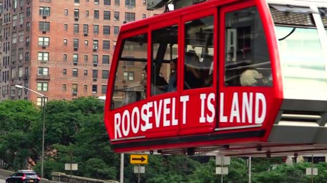 roosevelt island tram – cable car – leaving manhattan / afternoon rush hour traffic entering and bypassing the ed koch queensboro 59th street bridge... - personal land vehicle stock videos & royalty-free footage