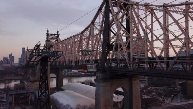 roosevelt island tramway sunset - cable car stock videos & royalty-free footage