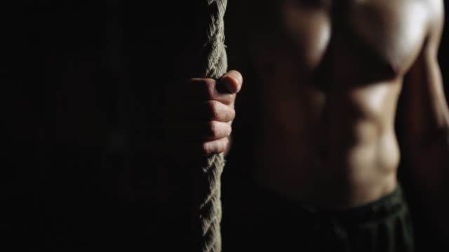 rope climbing at gym on night training - clambering stock videos & royalty-free footage