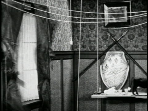 b/w 1923 rope lifting blankets onto windows / they become curtains / short - 1923 stock-videos und b-roll-filmmaterial