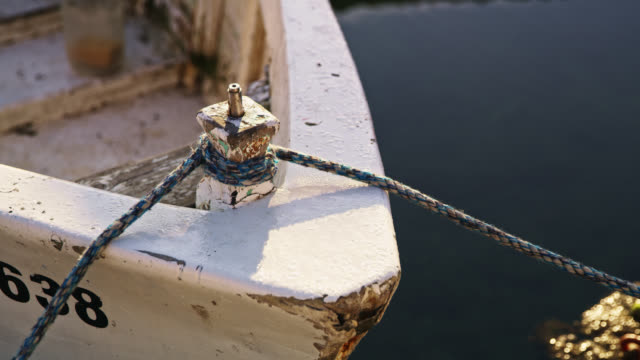 ds rope of an old boat moored on a pier - fishing village stock videos and b-roll footage