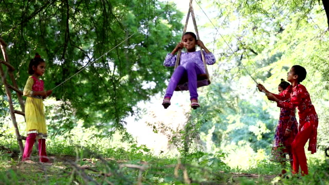 rope swing on a tree during teej festival - rope swing stock videos & royalty-free footage